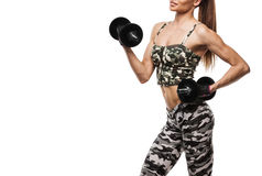 Atletische jonge dame die training met gewichten doen stock afbeeldingen