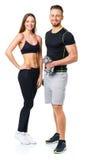 Atletische man en vrouw met domoren op het wit Royalty-vrije Stock Foto