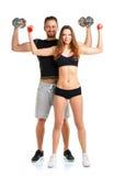 Atletische man en vrouw met domoren op het wit Stock Foto's