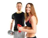 Atletische man en vrouw met domoren op het wit Royalty-vrije Stock Afbeeldingen