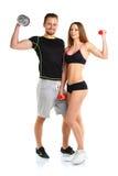 Atletische man en vrouw met domoren op het wit Royalty-vrije Stock Fotografie