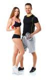Atletische man en vrouw met domoren op het wit Stock Afbeelding