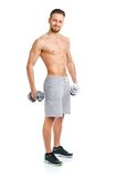 Atletische mens met domoren op het wit Royalty-vrije Stock Foto