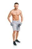 Atletische mens met domoren op het wit Stock Foto's