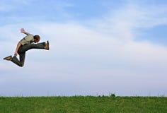 Atletische sprong Stock Foto's