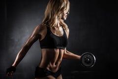 Atletische Vrouw met Domoren stock afbeelding
