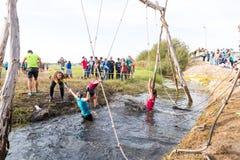 Atlety iść przez błota i wody Obraz Stock