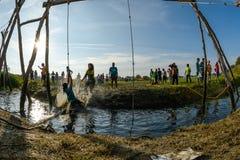 Atlety iść przez błota i wody Obraz Royalty Free