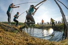 Atlety iść przez błota i wody Obrazy Stock