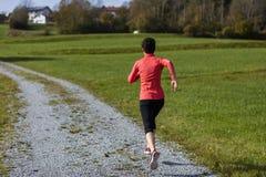 Atlety kobieta biega outdoors Obraz Stock