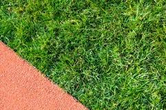 Atletyka bieg trawy w stadium i ślad Mistrz, tło zdjęcie stock