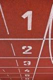 atletyka pasa ruchu liczb ślad Fotografia Royalty Free