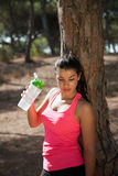 Atlhete with water bottle cooling down after sports Royalty Free Stock Photo