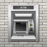 ATM Bank Cash Machine on a Brick Wall Background Royalty Free Stock Photography