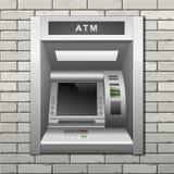 Atm-bankbankomat på en bakgrund för tegelstenvägg Royaltyfri Fotografi