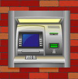 Atm on a brick wall Stock Images