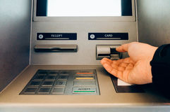 ATM cash machine. Hand of person using an ATM cash machine Royalty Free Stock Images