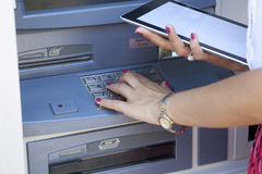 ATM cash machine and tablet pc Royalty Free Stock Image