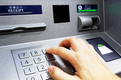 ATM - entering pin Royalty Free Stock Photos
