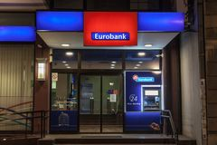 ATM in the Eurobank EFG Serbia`s main office in the center of Belgrade. Eurobank is Greece`s 3rd bank. Picture of the logo of EFG Eurobank on their Serbian stock images