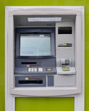 ATM on a green background Stock Photos