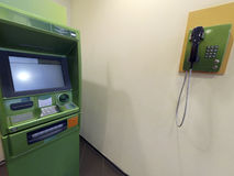 ATM for issuing money and the phone Royalty Free Stock Images
