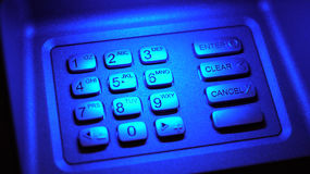 ATM key pad. Blue illuminated automatic teller machine keypad, ATM Stock Photo