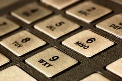 ATM KEYPAD. Close-up of metallic keypad of an automated teller machine Royalty Free Stock Photos