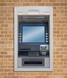 Atm machine. Front view, on brick's wall Stock Photos