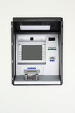 Atm machine. On a white wall Royalty Free Stock Images