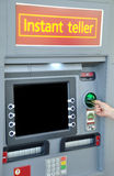 ATM machine. Someone inserting a card into a ATM machine Royalty Free Stock Photos