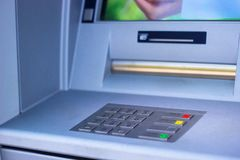 ATM machine blue background. Business Finance and Industry royalty free stock photography
