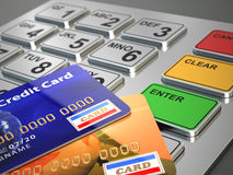 ATM machine keypad with credit cards. Stock Photos