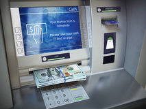 ATM machine and money. Withdrawing dollar banknotes. Royalty Free Stock Image