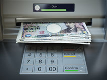 ATM machine and money. Withdrawing yen banknotes. Stock Photography
