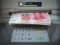 ATM machine and money. Withdrawing yuan banknotes. Royalty Free Stock Photography