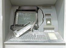 Atm-maskin med brutet exponeringsglas royaltyfri foto