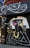 Atm-maskin med graffitymålning royaltyfria bilder