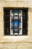 ATM maszyna blokująca za więźniarskimi barami Fotografia Royalty Free