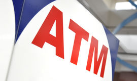 ATM Money Machine Closeup. A closeup of an automated teller machine or atm with red text. Use the photo for banking, security or finance themes Stock Photo