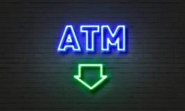 ATM neonowy znak na ściana z cegieł tle obraz royalty free