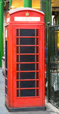 ATM in Old British Phone Booth. In London Stock Photo
