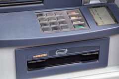 ATM ready to issue money. Stock Photo