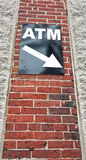 ATM Sign. Attached to brick wall pointing down. Vertical Royalty Free Stock Photography
