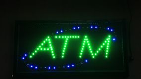 ATM sign at night