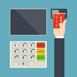 ATM terminal and hand with credit card Stock Photo
