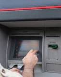 ATM withdraw. Man selecting amount to withdraw from ATM Royalty Free Stock Photography