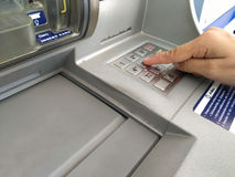 ATM for withdraw your money. Hand entering PIN numbers on ATM Royalty Free Stock Images