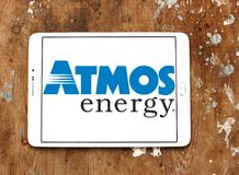 Atmos Energy logo. Logo of Atmos Energy on samsung tablet on wooden background. Atmos Energy Corporation, headquartered in Dallas, Texas, is one of the United Royalty Free Stock Photo