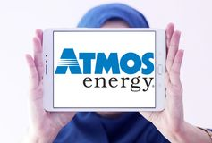 Atmos Energy logo. Logo of Atmos Energy on samsung tablet holded by arab muslim woman. Atmos Energy Corporation, headquartered in Dallas, Texas, is one of the Stock Photos